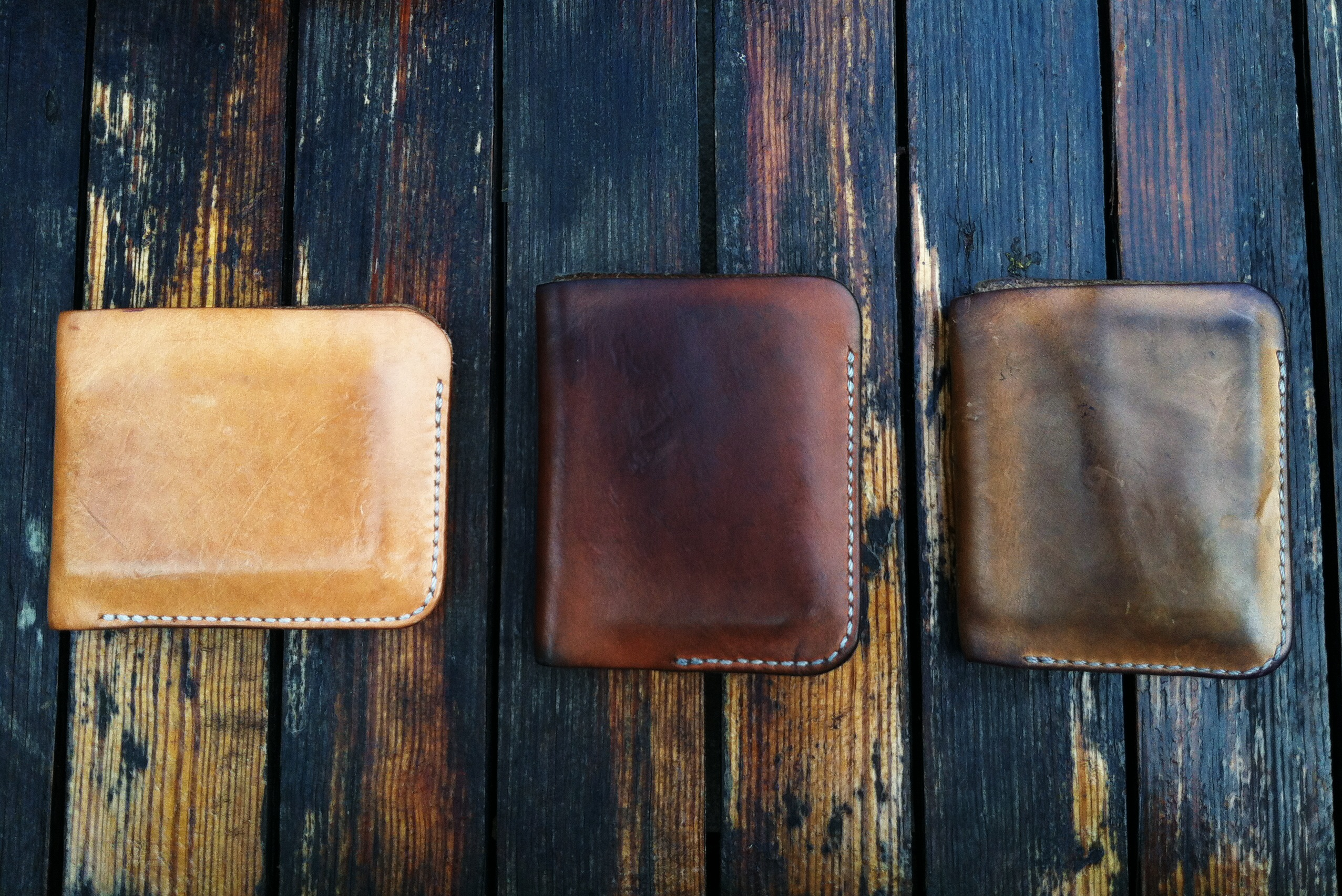 Handmade leather wallets aged over time